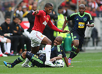 Manchester United's Valencia against Ajax Cape Town's Aidan Jenniker during their International friendly match at Cape Town Stadium