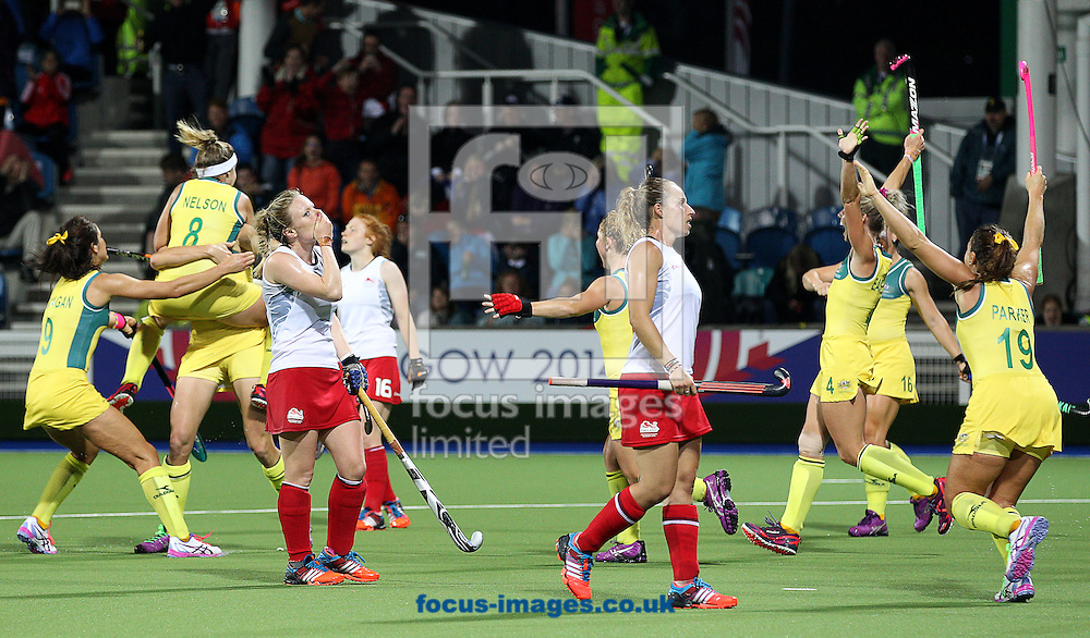 The Australian team celebrate as the England team look dejected after the Women's Final during day ten of the Hockey at Glasgow National Hockey Centre, during the Glasgow 2014 Commonwealth Games.<br /> Picture by Paul Terry/Focus Images Ltd +44 7545 642257<br /> 02/08/2014