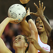 Cathrine Latu, New Zealand, prepares to shoot while challenged by  Ama Agbeze, England (right) and Eboni Beckford-Chambers, England, (behind) during the New Zealand V England, New World International Netball Series, at the ILT Velodrome, Invercargill, New Zealand. 6th October 2011. Photo Tim Clayton..