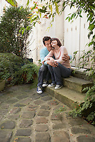 Couple embracing sitting on steps