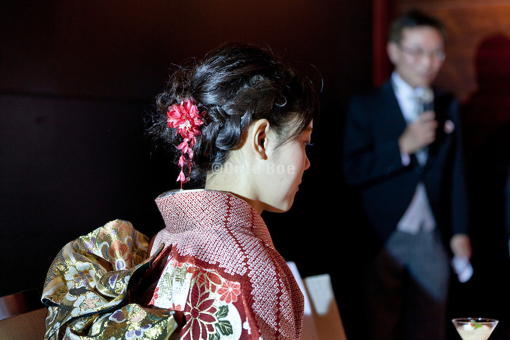young adult woman in the traditional formal furisode style kimono dress for unmarried women listening to father speaking Japan