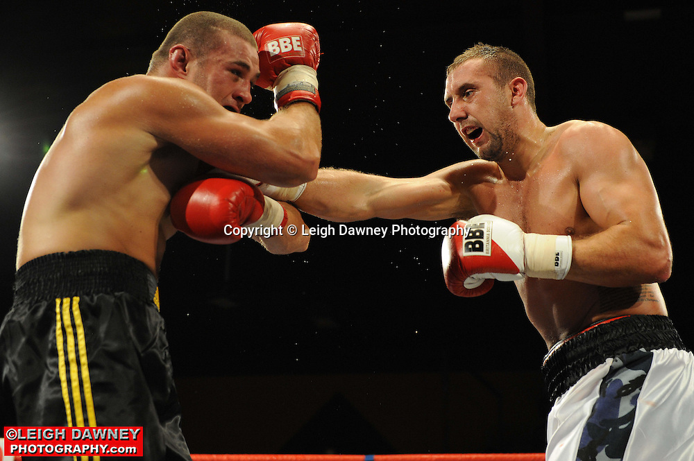 Jon Lewis Dickinson (grey shorts) defeats Richard Turba at Rainton Meadows Arena, Sunderland, 11th September 2010. Frank Maloney Promotions. © Photo credit: Leigh Dawney