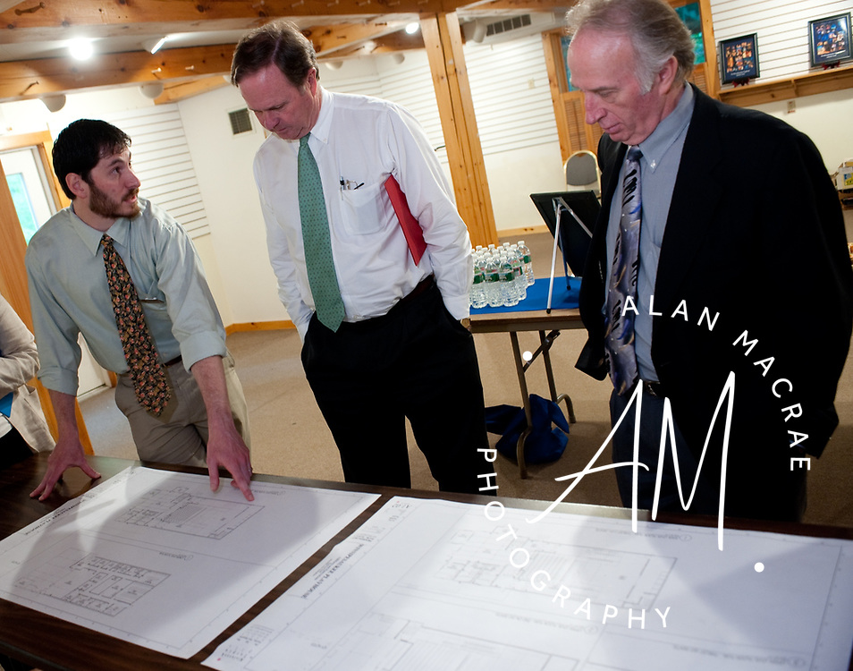 Brian Halperin shows plans for the new home of the Winnipesaukee Playhouse to Sam Laverack of Meredith Village Savings and NH Cultural Commissioner Van McLeod on in Meredith on Monday, June 1, 2010.  (Alan MacRae/for the Citizen)