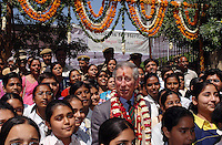 Prince Charles,Prince of Wales, garlanded and with a tilak mark on his forehead, tours the old city of Jaipur in India on March 31, 2006. .Photo:  Anwar Hussein