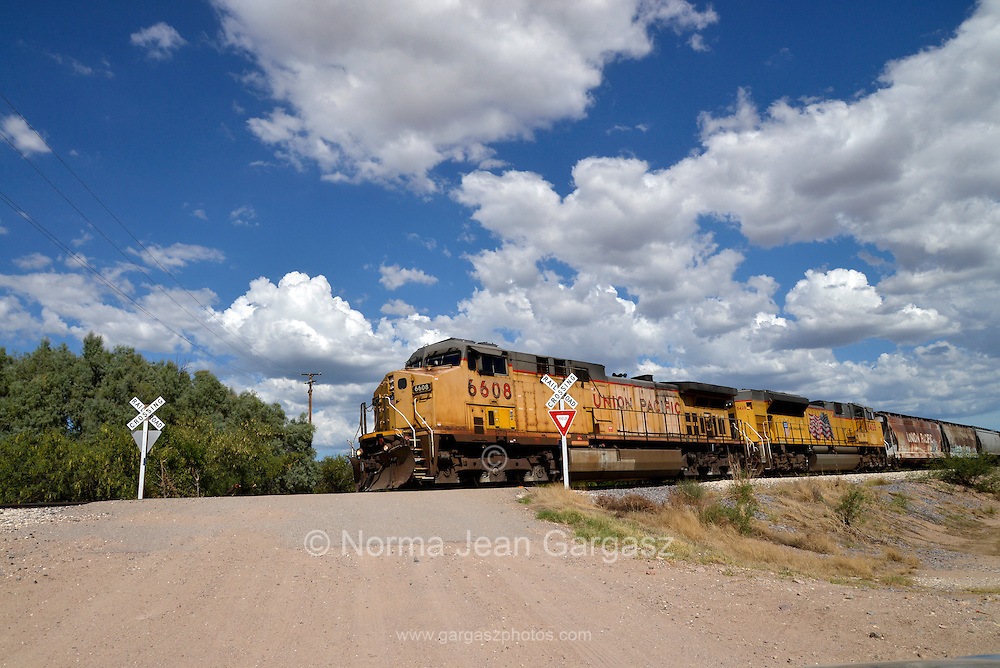 A cargo train heads north from Nogales, Sonora, Mexico at Tubac, Arizona, USA.