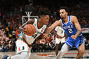 January 15, 2018: Lonnie Walker IV #4 of Miami drives on Gary Trent, Jr. #2 of Duke during the NCAA basketball game between the Miami Hurricanes and the Duke Blue Devils in Coral Gables, Florida. The Blue Devils defeated the 'Canes 83-75.