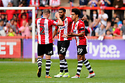 Pierce Sweeney (2) of Exeter City, Luke Croll (23) of Exeter City and Troy Brown (39) of Exeter City celebrate the 1-0 win over Lincoln City at full time during the EFL Sky Bet League 2 match between Exeter City and Lincoln City at St James' Park, Exeter, England on 19 August 2017. Photo by Graham Hunt.