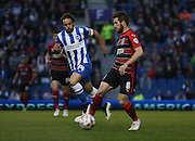 Huddersfield Town AFC midfielder Jacob Butterfield and Inigo Calderon, Brighton defender during the Sky Bet Championship match between Brighton and Hove Albion and Huddersfield Town at the American Express Community Stadium, Brighton and Hove, England on 14 April 2015.