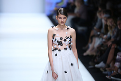 July 2, 2018 - Berlin, Germany - The photo shows a model on the catwalk with the autumn and winter collection ''Lineless Light'' by the designer Guido Maria Kretschmer. (Credit Image: © Simone Kuhlmey/Pacific Press via ZUMA Wire)