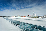 Ships line the riverbank in Inuvik. When the ice road melts away, ship traffic starts up again.