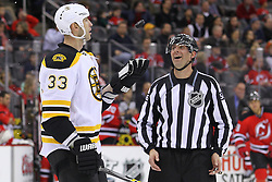 Jan 4, 2012; Newark, NJ, USA; Boston Bruins defenseman Zdeno Chara (33) juggles a puck on a stoppage during the second period at the Prudential Center.