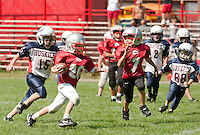Laconia Chiefs Logan Dee and Plymouth Huskies Ian Tryder during the U3 division scrimmage at the 5th annual Laconia Youth Football Jamboree on Saturday. (Karen Bobotas/for the Laconia Daily Sun)Laconia Youth Football Jamboree Saturday,  August 20, 2011.