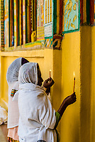 Women holding candles and praying, Saint Yared Church (Ethiopian Orthodox Church), Axum (Aksum), Ethiopia.