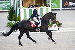 Melanie Hofmann, (SUI), Gb Cazzago C - Grand Prix Team Competition Dressage - Alltech FEI World Equestrian Games™ 2014 - Normandy, France.<br /> © Hippo Foto Team - Leanjo de Koster<br /> 25/06/14