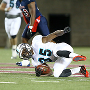 Kendrick Rhodes #35 of the Blacktips falls to the ground during the first ever Boston Brawlers home game at Harvard Stadium on October 24, 2014 in Boston, Massachusetts. (Photo by Elan Kawesch)