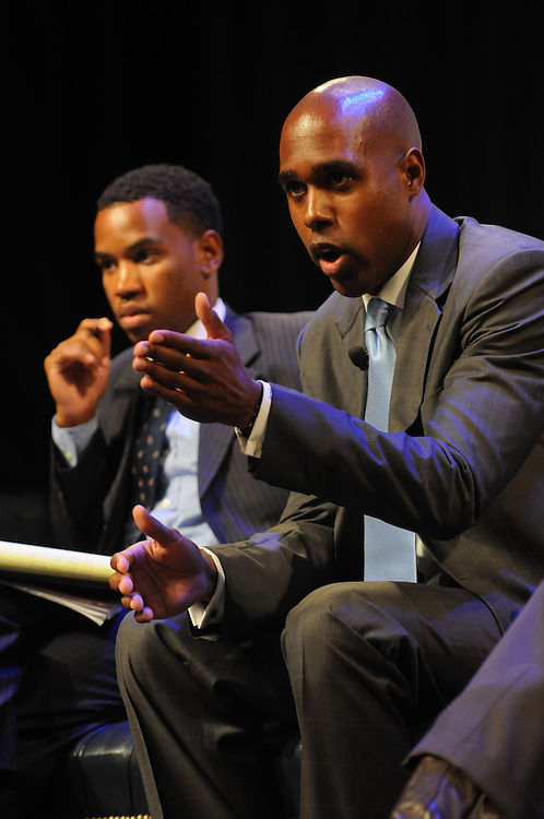 Albert Sanders Jr. , right, talks during a panel discussion about the impact of the youth vote on the 2012 elections during the Presidential Symposium at Howard University Thursday August 30, 2012.  Anre Washington, left, President of Student Government Association at Morehouse College, listens. The Symposium is just one of several events surrounding the AT&Ts  Nations Football Classic between Howard University and Morehouse University.  (Photo by Alan Lessig)