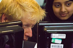 Camden City Learning Centre, London, June 15th 2015. London Mayor Boris Johnson joins future entrepreneurs at Camden City Learning Centre to launch London Technology Week and to launch a dedicated online hub for the Capital's thriving technology industry. PICTURED: Boris johnson watches students programming their robots.