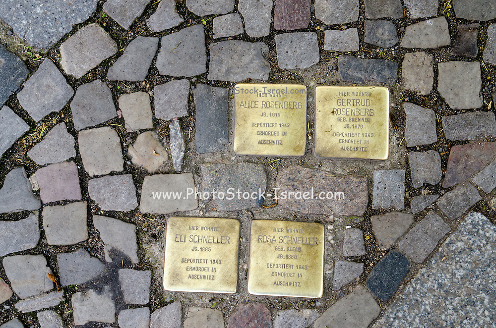 Memorial plaques (Stolpersteine) set into the pavement in Berlin to commemorate the deportation and murder of a Jew residant at that location