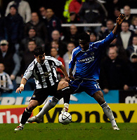 Photo: Jed Wee.<br /> Newcastle United v Chelsea. Carling Cup. 20/12/2006.<br /> <br /> Newcastle's Emre (L) holds off Chelsea's John Obi Mikel.