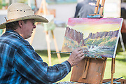 Painter Tex Archer working at his easel during the Thousand Springs Art Festival at Ritter Island near Hagerman, Idaho. VMR