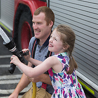 Fireman Gerard Hennesy with his neice Laoise Murrihy from Ennis sqwerting  the hose during the Kilkee by the Sea Festival 2018
