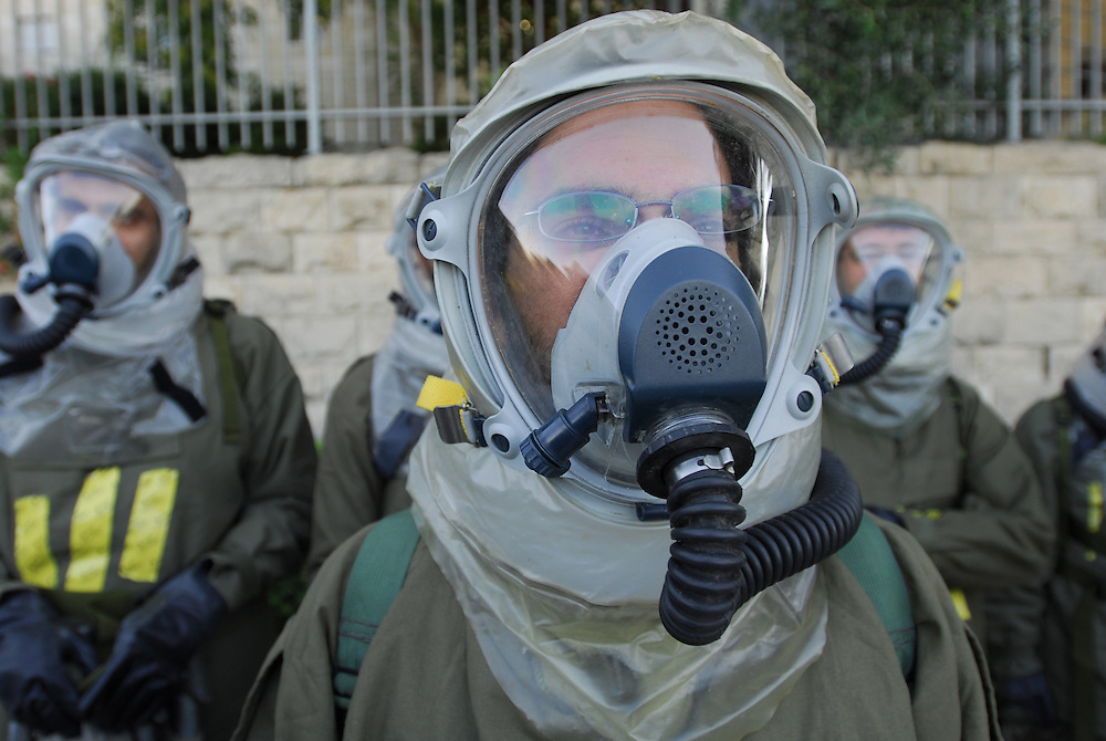 JERUSALEM, ISRAEL : JULY 23, 2009 - IDF Home Front Command soldiers, waering chemical protection gear, participate a Home Front  Command drill simulating chemical missiles attack over Israel. Home Front Command's rescue battalions are trained for rescueing trapped people from destruction sites as well as from sites hit by chemical missiles.