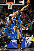 April 13, 2011; Cleveland, OH, USA; Washington Wizards center JaVale McGee (34) grabs a rebond over Cleveland Cavaliers center Ryan Hollins (5) during the third quarter at Quicken Loans Arena. The Cavaliers beat the Wizards 100-93. Mandatory Credit: Jason Miller-US PRESSWIRE