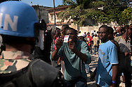 Supporters of Haitian presidential candidate Michel Martelly taunted UN peacekeepers in city-wide protests after the announcement of preliminary election results.