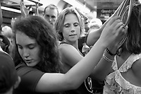 On board a crowded Red Line train near the Grand stop, Chantelle Sieren, of Cedar Rapids, Iowa, at center, rides toward Wrigley Field with her niece Olivia Gassman, 16, at left. The families were headed to see the Chicago Cubs play the Minnesota Twins. The Cubs won 10-6.<br />