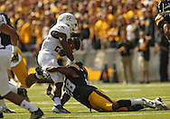 September 21 2013: Western Michigan Broncos running back Dareyon Chance (22) is hit by Iowa Hawkeyes' Maurice Fleming (28) during the second quarter of the NCAA football game between the Western Michigan Broncos and the Iowa Hawkeyes at Kinnick Stadium in Iowa City, Iowa on September 21, 2013. Iowa defeated Western Michigan 59-3.