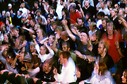 A large crowd of people dancing, clapping and waving their hands in the air. Quart festival, Kristiansands Norway 2000