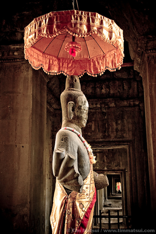 A buddha in the entrance to Angkor Wat, one of the seven wonders of the ancient world in Siem Reap, Cambodia.