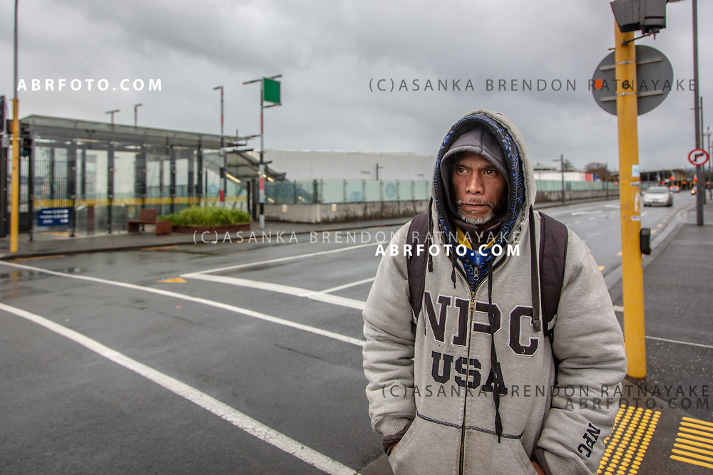 Joseph Takairangi waiting at an intersection in New Lynn on the 6th of June 2018. Asanka Brendon Ratnayake for The New York Times.