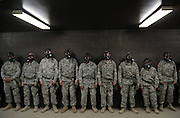Drill Sergeant candidates test their masks inside the NBC (nuclear biological chemical) chamber where CBRN (Chemical, Biological, Radiological, and Nuclear) training is conducted.