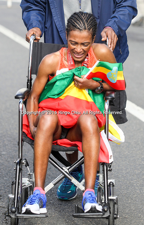 Serkalem Abrha of Ethiopia, helps with wheelchair after finished in second place in the 31st Los Angeles Marathon in Los Angeles, Sunday, Feb. 14, 2016. The 26.2-mile marathon started at Dodger Stadium and finished at Santa Monica.  (Photo by Ringo Chiu/PHOTOFORMULA.com)<br /> <br /> Usage Notes: This content is intended for editorial use only. For other uses, additional clearances may be required.