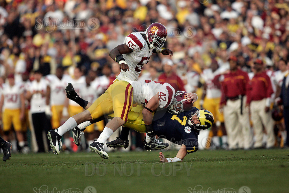 1 January 2007: #42 Dallas Sartz sacks quarterback Chad Henne at the 93rd Rose Bowl Game at the Rose Bowl Stadium for the Pac-10 USC Trojans vs the Big-10 Michigan Wolverines NCAA college football game in Southern California.  Trojans defeated the Wolverines 32-18 in regulation.<br />