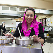 Slough, Greater London, UK, January 24, 2015.<br /> In the kitchen of the Ramgharia Sikh Gurdwara Temple in Slough, men and women work together. More and more women are now becoming independent through their work, from kitchens to banks