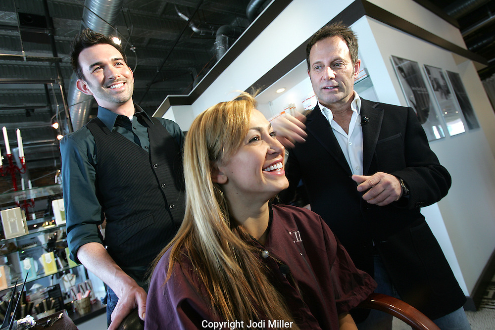 Jacob Neal (right) of Jacob Neal Salon and senior stylist Drew Grudowski (left) talk with Dancing with the Star's Karina Smirnof about color during a recent makeover at Neal's Columbus Salon.(Jodi Miller/Alive)