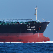 Large vessels like this one travel on a constant basis in the shipping lanes just south of Sri Lanka. The ships travel at high speed, as is apparent from the bow wake in this image. The shipping lanes pass through the middle of feeding grounds for blue whales and other cetaceans, making the risk of ship strikes in this region high.