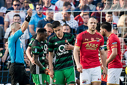 (L-R) referee Bjorn Kuipers, Alireza Jahanbakhsh of AZ during the Dutch Toto KNVB Cup Final match between AZ Alkmaar and Feyenoord on April 22, 2018 at the Kuip stadium in Rotterdam, The Netherlands.