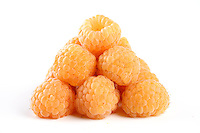 Close-up of yellow raspberries on wite background