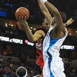 06 February 2009:  Toronto Raptors guard Joey Graham (14) shoots as Hornets players James Posey (41) and Rasual Butler (45) defend the play during a NBA game between the New Orleans Hornets and the Toronto Raptors at the New Orleans Arena in New Orleans, LA.