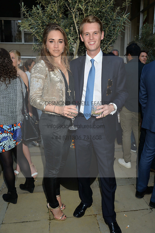 IMOGEN HERVEY-BATHURST and DAVID TOLLEMACHE at a party to celebrate the launch of Le Jardin de Monsieur Li by Hermes in association with Mr Fogg's was held at Hermes, 155 New Bond Street, London on 9th July 2015.