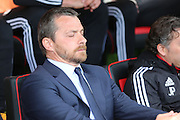 Fulham head coach, Slavisa Jokanovic with his eyes shut during the Sky Bet Championship match between Brentford and Fulham at Griffin Park, London, England on 30 April 2016. Photo by Matthew Redman.
