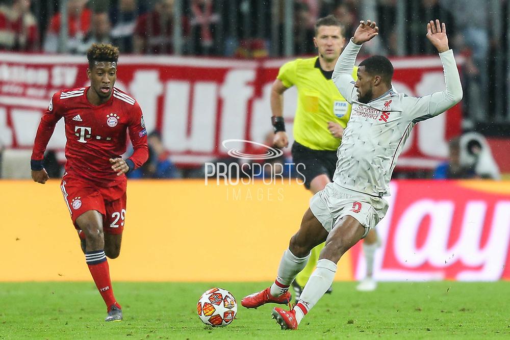 Liverpool midfielder Georginio Wijnaldum (5) kicks the ball away from the path of Bayern Munich midfielder Kingsley Coman (29) during the Champions League match between Bayern Munich and Liverpool at the Allianz Arena, Munich, Germany, on 13 March 2019.