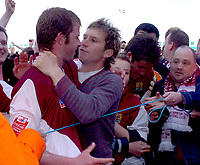 Photo: Ian Hebden.<br />Northampton Town v Chester City. Coca Cola League 2. 29/04/2006.<br />Northampton Towns martin Smith (L) and Chris Doig (R) are mobbed by the crowd at the final whistle.