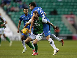 Hibernian's Martin Boyle (front) battles with Molde's Vegard Forren during the UEFA Europa League third qualifying round, first leg match at Easter Road, Edinburgh.