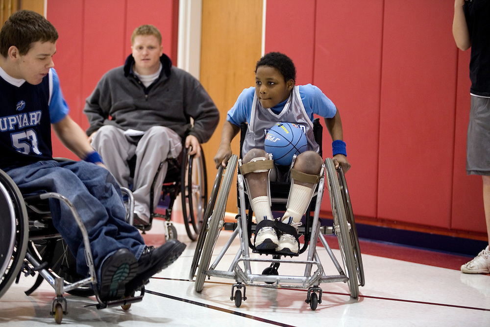 "Kellogg Foundation Assignment: Wheelchair Basketball..Coach Bretty Harbage in the background...The contact is Pam Patula, 888/957-6245 runs an organization.called Socil (S.E. center for Independent Living )a member of April.  A weekly wheelchair basketball game in Lancaster, held on Jan 20th. Saturday at 10am. The basketball coach, Brett Harbage, is an Independent Living Specialist from SOCIL.  Other coach is Cheryl ""Hutch"" Hutchinson, she is the adaptive physical education instructor of Fairfield County.  The adaptive basketball games are part of the Upward Basketball league, .  This is only Upwards adaptive league in the nation."
