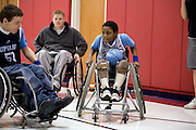 """Kellogg Foundation Assignment: Wheelchair Basketball..Coach Bretty Harbage in the background...The contact is Pam Patula, 888/957-6245 runs an organization.called Socil (S.E. center for Independent Living )a member of April.  A weekly wheelchair basketball game in Lancaster, held on Jan 20th. Saturday at 10am. The basketball coach, Brett Harbage, is an Independent Living Specialist from SOCIL.  Other coach is Cheryl """"Hutch"""" Hutchinson, she is the adaptive physical education instructor of Fairfield County.  The adaptive basketball games are part of the Upward Basketball league, .  This is only Upwards adaptive league in the nation."""