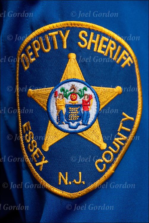 Close up of Deputy Sheriff Essex NJ County emblem patch on officer's uniform.